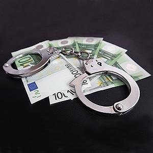 Handschellen mit Geldscheinen